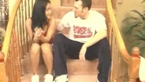 An amateur couple is having a casual threesome with naughty girls, on the stairs in the apartment